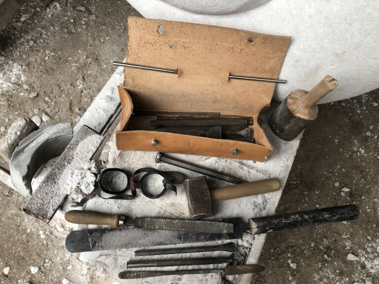 a selection of hand tools for carving stone