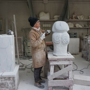 woman carving in stone